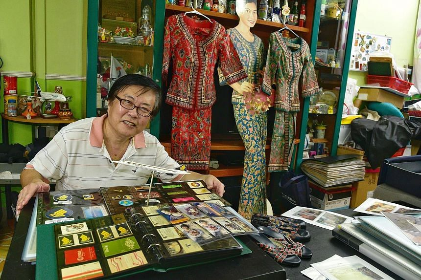Mr Eddie Yong started his collection of SIA memorabilia, seen here in his Toa Payoh flat, after being inspired by an exhibition in 1997. His pocket albums are filled with phone cards, stickers and matchboxes.