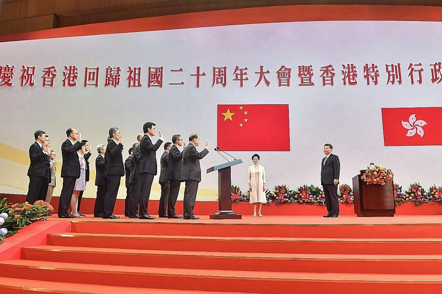 Hong Kong saw its new Chief Executive, Mrs Carrie Lam, and her Cabinet sworn in by Chinese President Xi Jinping on the 20th anniversary of the city's handover to China yesterday, a day also marked by protests. In his speech, Mr Xi warned that challen