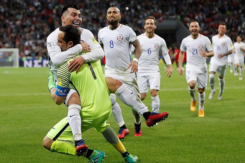 Gary Medel leaps into Claudio Bravo's arms after the Chilean goalie saved three penalties to seal victory against Portugal. Bravo's children always expect him to bring home silverware.