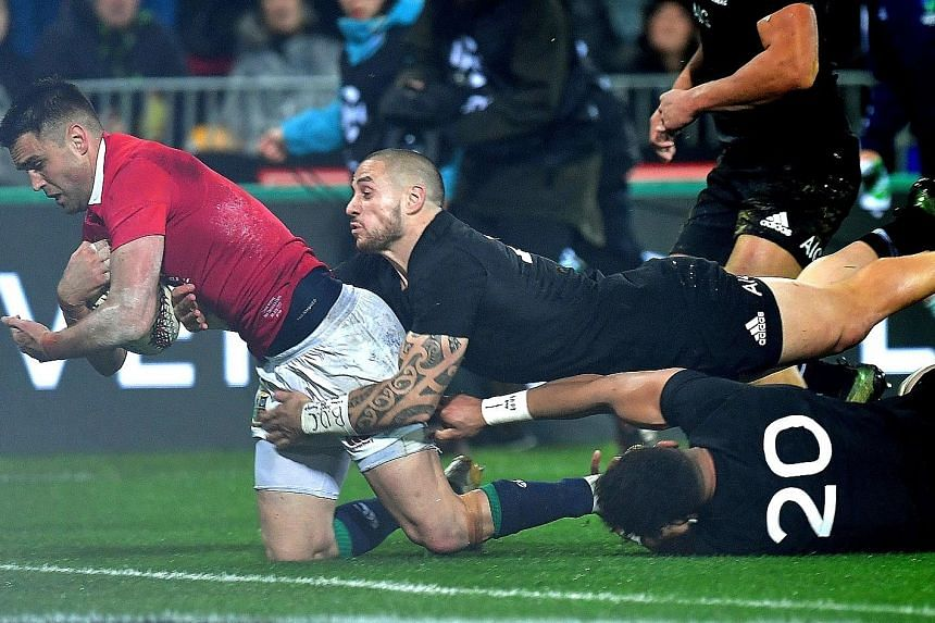 Above: Sonny Bill Williams of the All Blacks tackles the British and Irish Lions' Anthony Watson during the second Test in Wellington yesterday. Williams was red-carded for the shoulder charge against Watson, becoming the first All Black in 50 years