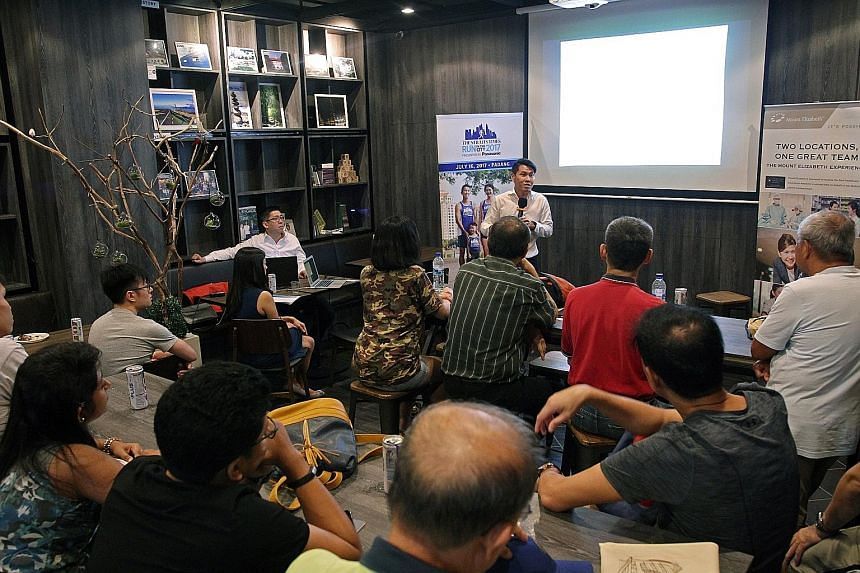 Above: ST Run participants preparing for the July 16 event by taking part in a 15km training run. Left: Dr Lim Kay Kiat giving tips to participants of the ST Run clinic on how to stay injury-free. Fellow orthopaedic specialist Dr Andy Wee (back, left