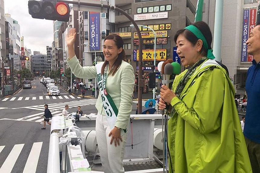 Tokyo Governor and head of Tomin First no Kai party Yuriko Koike taking her message to voters yesterday. Beside her is a candidate from the party, Ms Airi Ryuen, 40, a naturalised Japanese citizen born in Sweden.