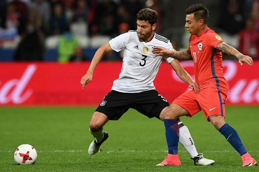 Germany defender Jonas Hector (left) vying with Chile forward Eduardo Vargas during their Confederations Cup match in Kazan on June 22, 2017.