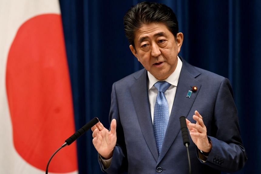 Japan Prime Minister Shinzo Abe answers a question during a press conference at his official residence in Tokyo on June 19, 2017.