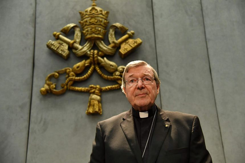 Australian Cardinal George Pell looks on as he makes a statement at the Holy See Press Office, Vatican city.