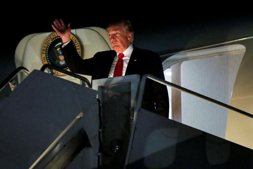 US President Donald Trump arrives at Morristown municipal airport, New Jersey, after attending the Celebrate Freedom Rally in Washington.