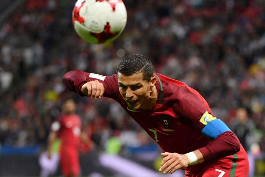 Ronaldo heads the ball during the semi-final against Chile.