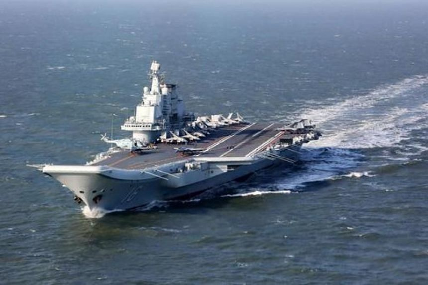 The Liaoning, China's first aircraft carrier, sailing during military drills in the Pacific.