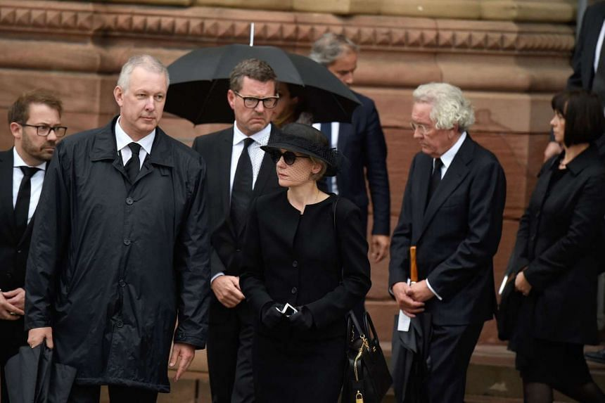 Kohl's widow Maike Kohl-Richter (centre) leave after the service.