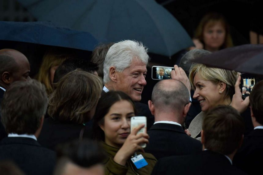 Former US president Bill Clinton attends the service.