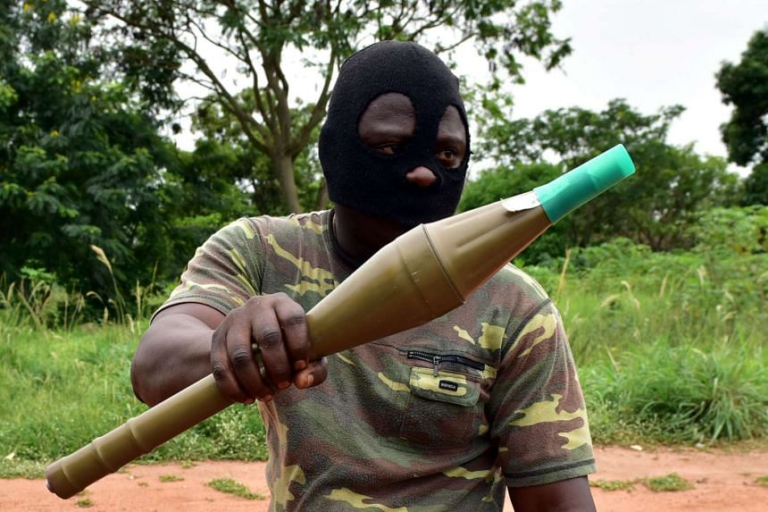 A mutinous Ivory Coast soldier holds an RPG rocket launcher, May 15, 2017.