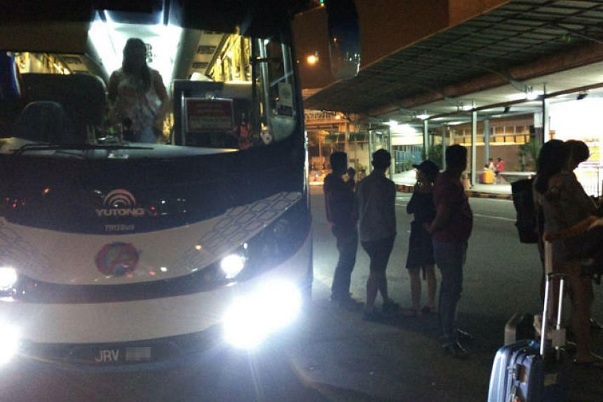 Passengers said a tour bus left with their belongings when they alighted to go through immigration in Malaysia at the Second Link.