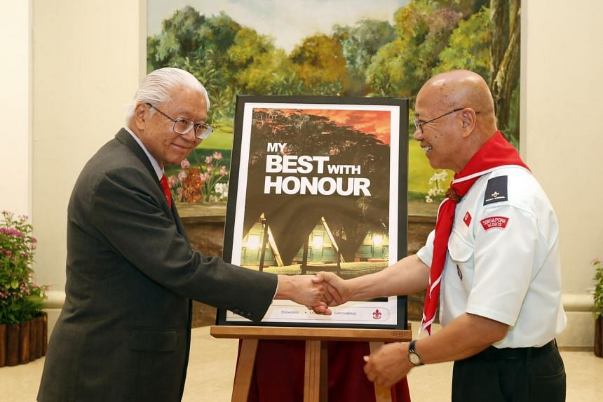 President Tony Tan (left) launching the book My Best With Honour with the author, Dr William Wan, at the Istana.