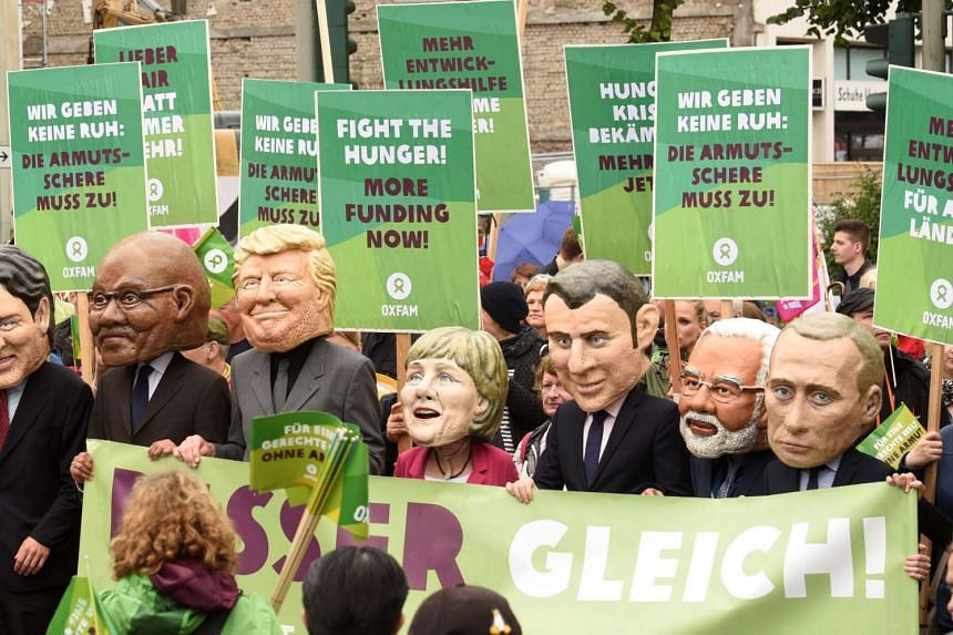 Oxfam's Big Heads depict G20 leaders take part in protests ahead of the upcoming G20 summit in Hamburg, Germany on July 2, 2017.