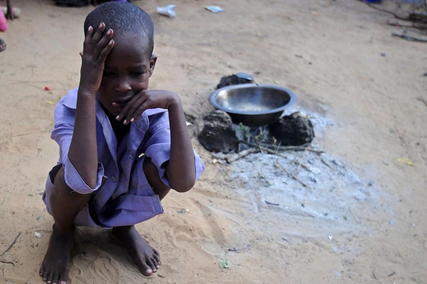 A displaced Somali child sitting at a makeshift camp in the Garasbaley area on the outskirts of the capital Mogadishu on May 24, 2017.