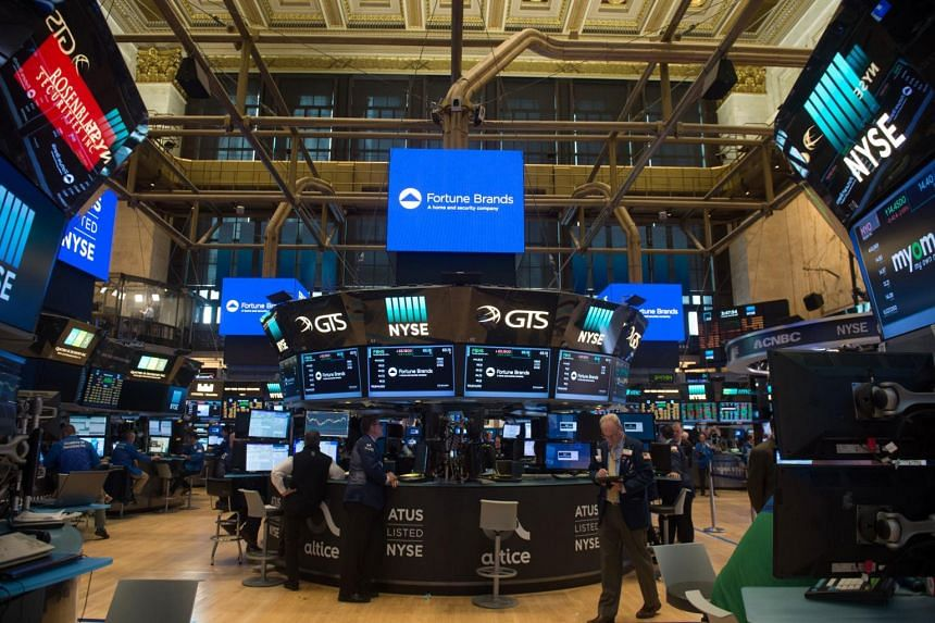 Traders working on the floor at the closing bell of the Dow Jones Industrial Average at the New York Stock Exchange on June 22, 2017 in New York.