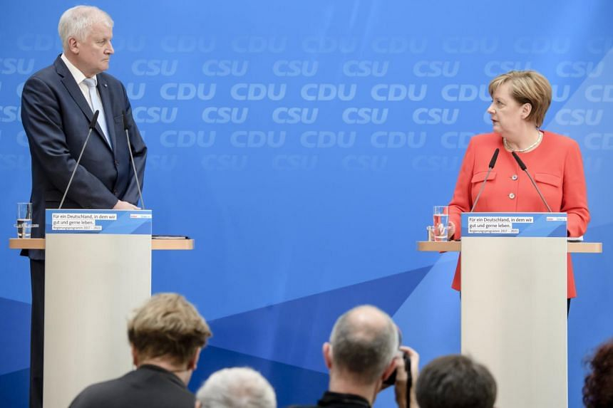 Angela Merkel (right) and Horst Seehofer addressing a joint press conference of the Christian Democratic Union and Christian Social Union with the Government Program in Berlin, Germany on July 3, 2017.