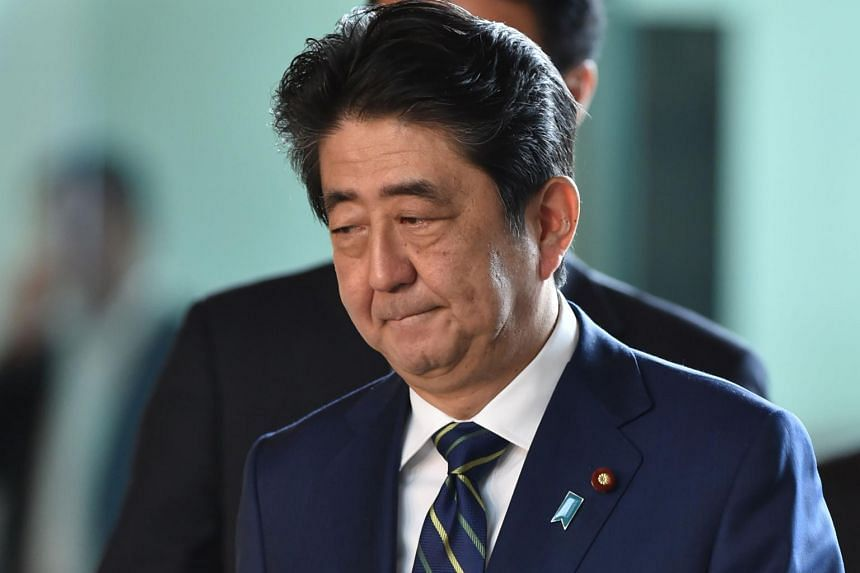 Japanese Prime Minister Shinzo Abe arriving at his official residence in Tokyo on July 3, 2017.