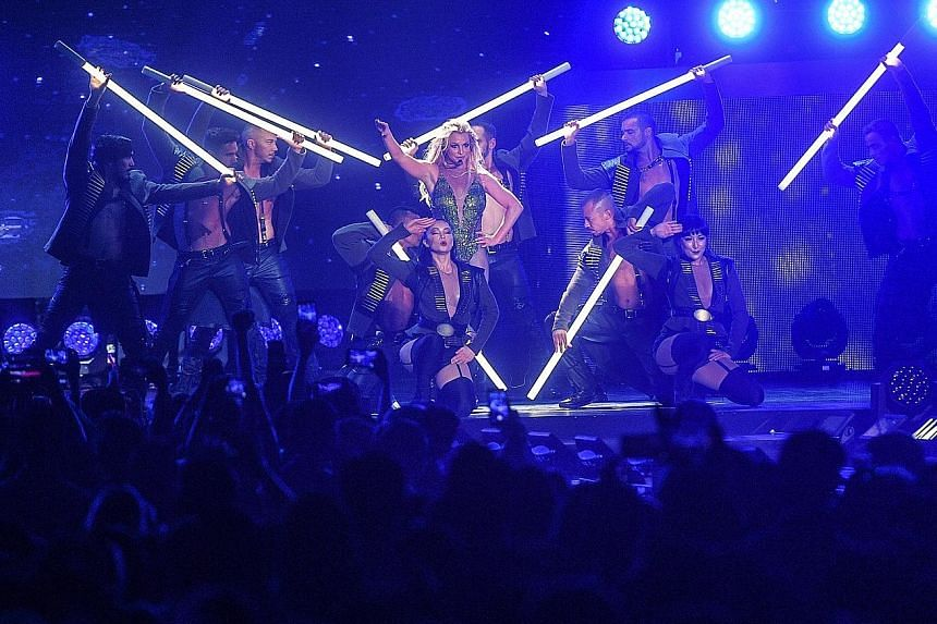 With clever projections and lighting and plenty of costume changes, Britney Spears took her fans through a gamut of scenes, from the club to the boudoir to the raunch of Las Vegas.