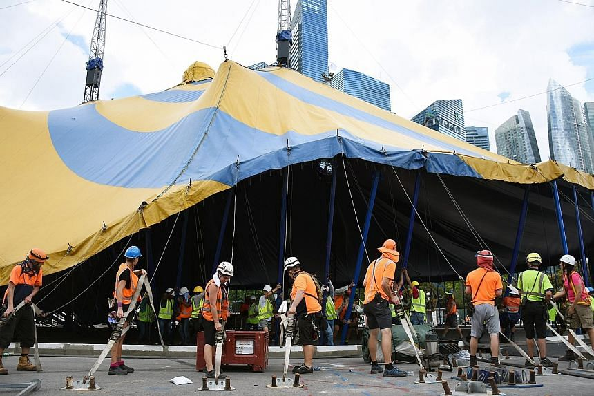 """Staff putting up Cirque du Soleil's iconic Big Top in Bayfront Avenue yesterday, marking the arrival of Kooza, its latest production. The 17m-tall tent can accommodate about 2,500 spectators. The performers of Kooza - inspired by the Sanskrit word """"k"""