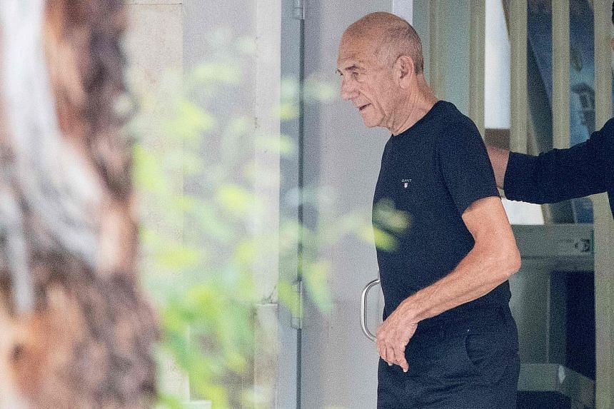 Mr Ehud Olmert leaving Maasiyahu prison yesterday. He was granted an early release by a parole board last week, shaving about a third off his 27-month sentence over corruption scandals.