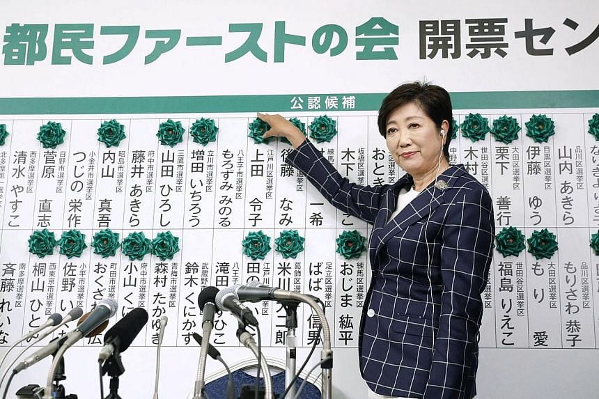 Tokyo Governor Yuriko Koike was kept busy adding paper flowers atop the names of elected members of her Tomin First party as the results came in for the city's metropolitan assembly election yesterday.
