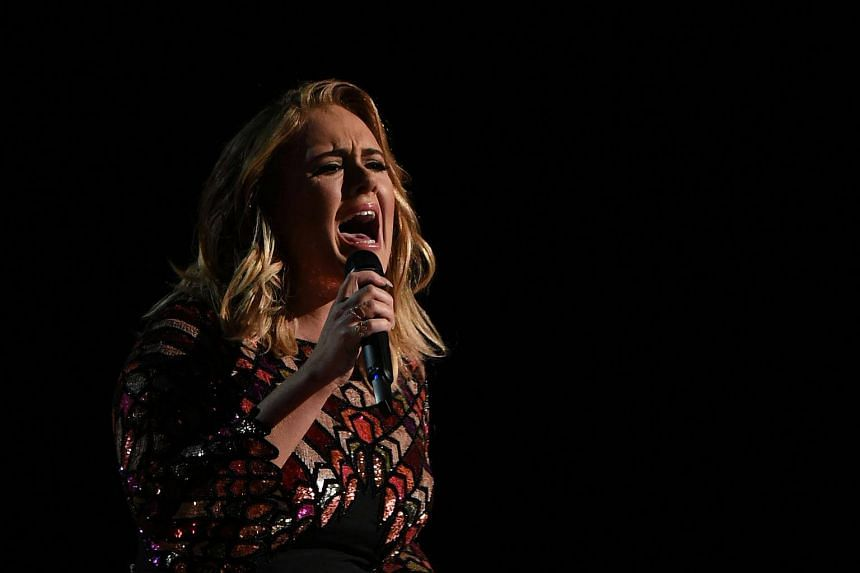 British singer Adele performs onstage during the 59th Annual Grammy music Awards in Los Angeles, California on Feb 13, 2017.