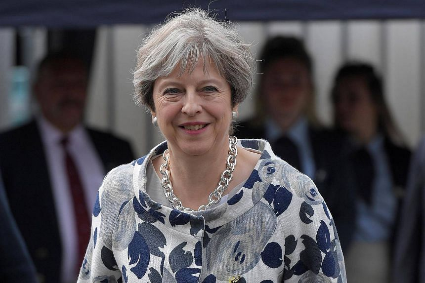 Britain's Prime Minister Theresa May leaves after attending the annual Henley Royal Regatta rowing festival in Henley-on-Thames, Britain, on June 30, 2017.
