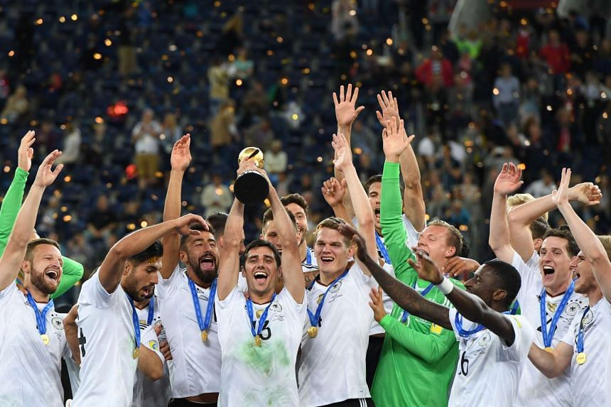 Germany's midfielder Lars Stindl lifts the trophy after winning the 2017 Confederations Cup final football match between Chile and Germany at the Saint Petersburg Stadium in Saint Petersburg on July 2, 2017.