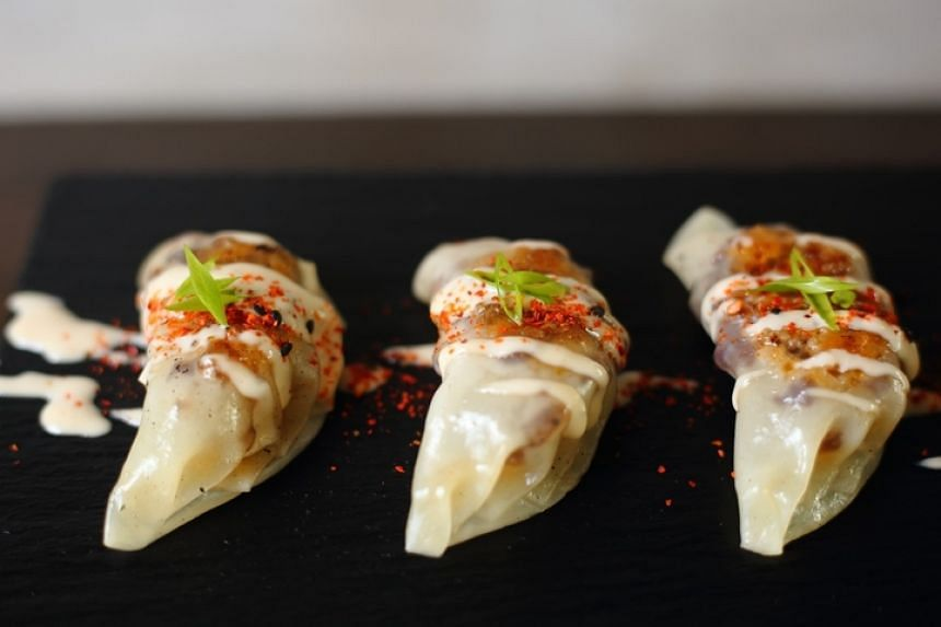 One of the best-sellers at Manila's Toast Asian Kitchen & Tasting Room is the Gyozig, which has sisig, a classic Filipino offal dish stuffed in dumplings.