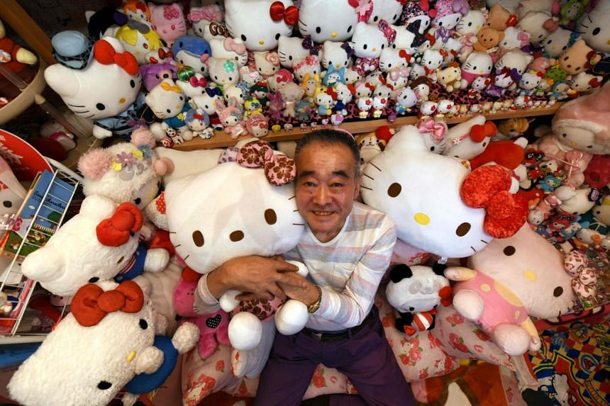 Retired Japanese police officer Masao Gunji posing with his Hello Kitty collection at his pink-painted Hello Kitty house in Yotsukaido, Chiba prefecture on June 28, 2017.