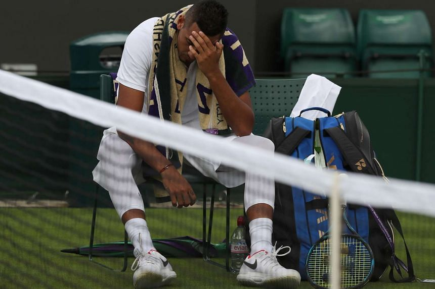 A frustrated Nick Kyrgios at the end of the second set, before retiring from his match against France's Pierre-Hugues Herbert on the first day of the Wimbledon Championships.