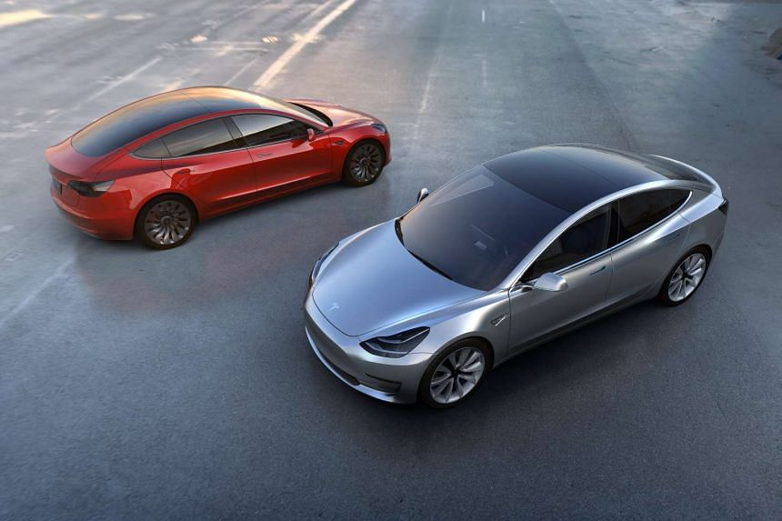 The Tesla Model 3 in red and silver.