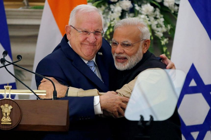 Israeli President Reuven Rivlin (left) and India's Prime Minister Narendra Modi hug each other after reading their joint statement at Hyderabad House in New Delhi, India, on Nov 15, 2016.