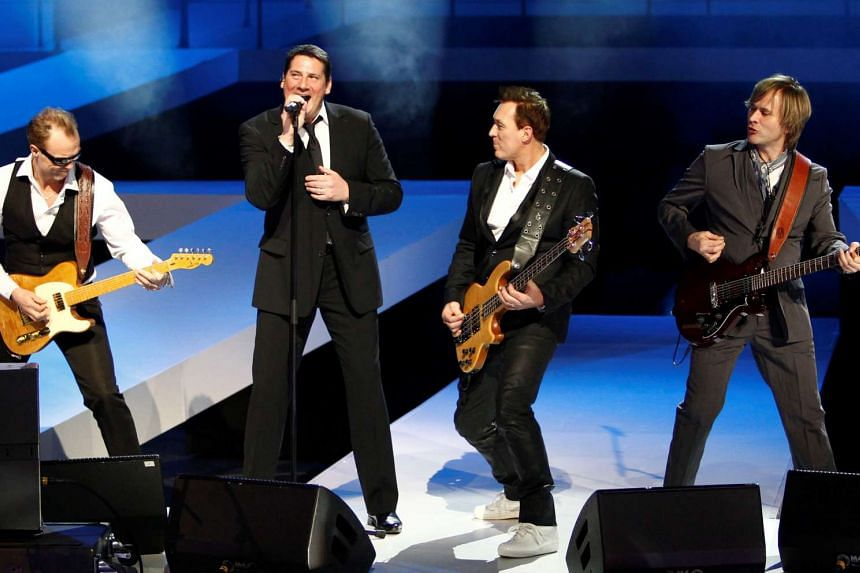 Members of British pop band Spandau Ballet, with Tony Hadley (second from left), perform at the Berlin Fashion Week in 2010. PHOTO: REUTERS