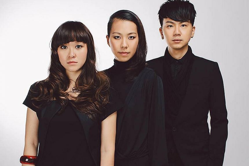 SA comprises (from far left) guzheng player Natalie Alexandra Tse, 30; percussion player Cheryl Ong, 31; and Andy Chia, 35, who plays the dizi or Chinese flute.