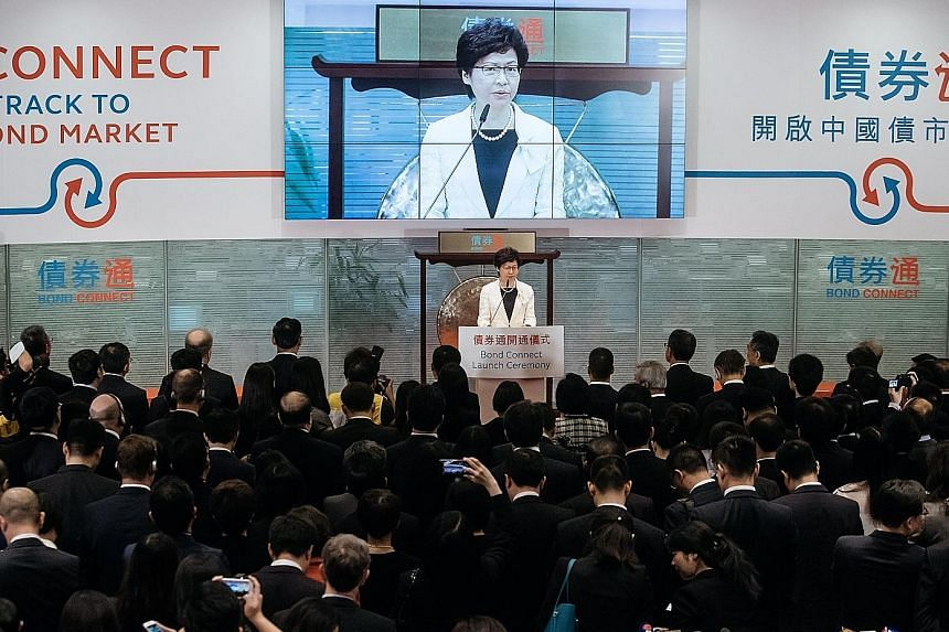 Chief Executive Carrie Lam at the launch of the China-Hong Kong Bond Connect at the Hong Kong stock exchange yesterday. The two offerings launched were intended to coincide with the 20th anniversary of Britain's handover of Hong Kong to China on July