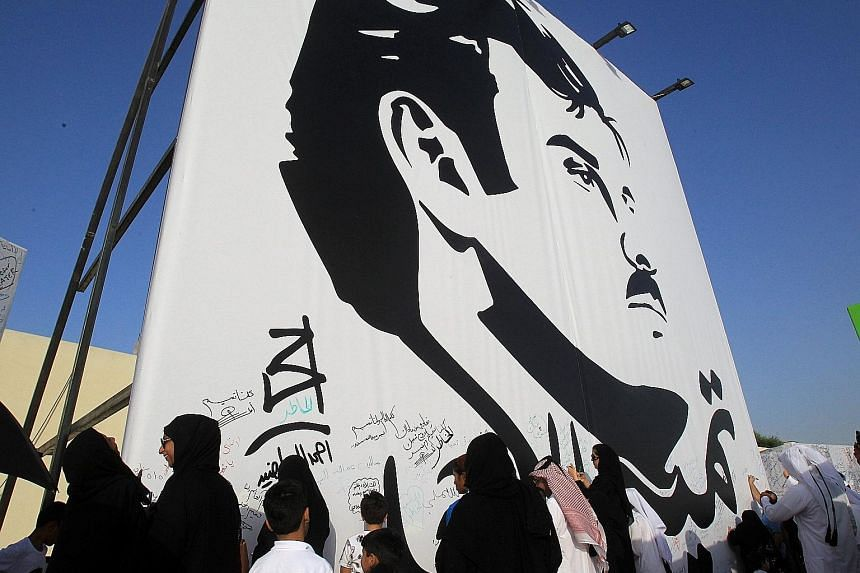 A huge painting of Qatar's Emir, Sheikh Tamim Hamad Al Thani, in a Doha public area. Qatar's Gulf neighbours plus Egypt are demanding that Doha ends its support for the Muslim Brotherhood, close broadcaster Al Jazeera and downgrade diplomatic ties wi