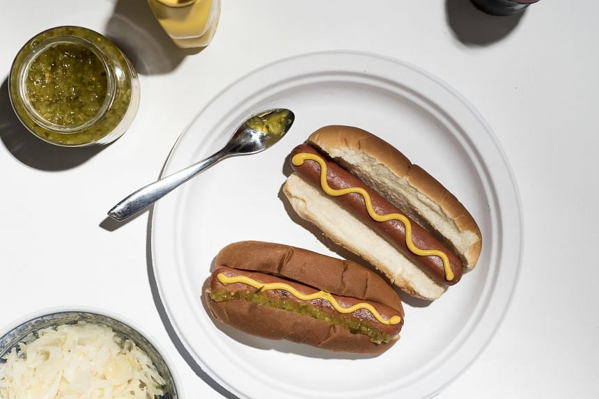 (From left) The Hebrew National hot dog, topped with mustard and relish, and the Wellshire Farms hot dog, topped with mustard, emerged winners in the taste test.