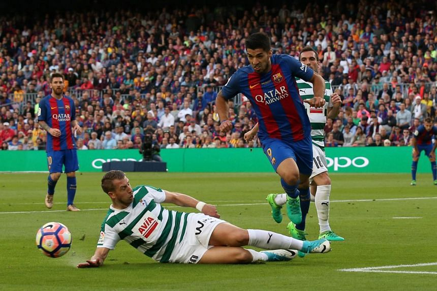 Barcelona's Luis Suarez in action with Eibar's Florian Lejeune during the Spanish Liga Santander  in Nou Camp, Barcelona, Spain on May 21, 2017.