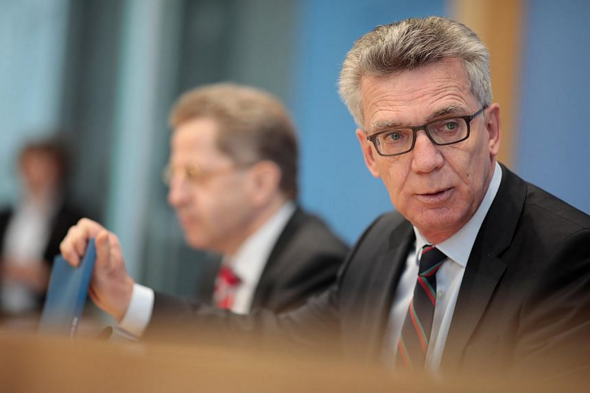 German Interior Minister Thomas de Maiziere addresses a news conference to introduce the agency's 2016 report on militant threats to the constitution in Berlin, Germany, July 4, 2017.