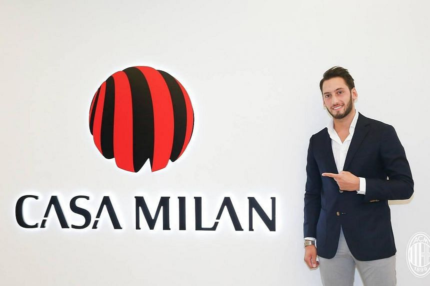 Turkish international midfielder Hakan Calhanoglu has joined AC Milan on a four-year deal.