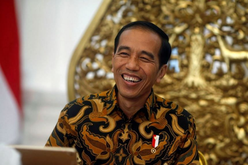 Indonesia's President Joko Widodo gestures during an interview with Reuters in Jakarta.