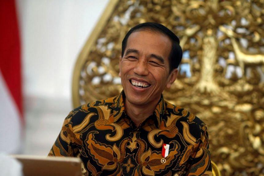 Indonesia's President Joko Widodo gestures during an interview with Reuters in Jakarta.