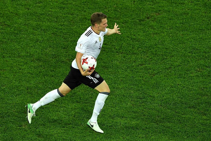 Germany's defender Matthias Ginter celebrates winning the 2017 Confederations Cup final football match between Chile and Germany at the Saint Petersburg Stadium in Saint Petersburg on July 2, 2017.