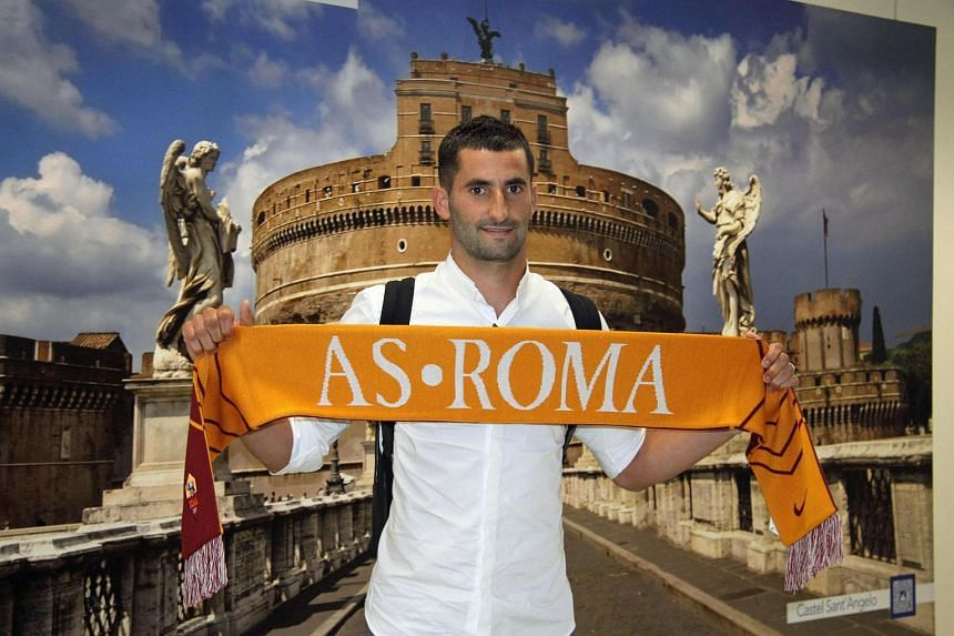French midfielder Maxime Gonalons arrives at Fiumicino Airport in Rome on July 2, 2017, to join Italian soccer club AS Roma after a five million Euro deal with Olympique Lyonnais.