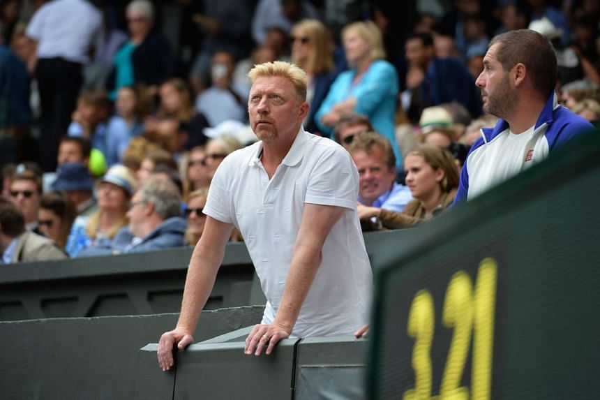 German tennis coach Boris Beckerstanding in the players box on Centre Court, on July 12, 2015.