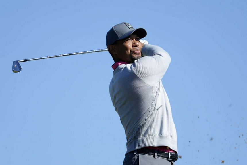 Tiger Woods plays his shot from the 15th tee during the first round of the Farmers Insurance Open.