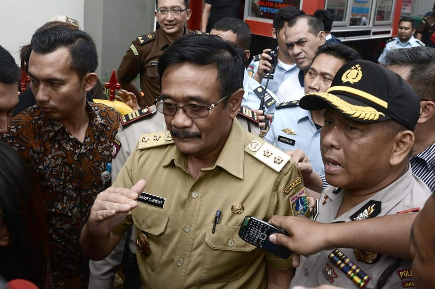 Jakarta Governor Djarot Saiful Hidayat (centre) has urged the public to be more vigilant after an ISIS flag was found at the police headquarters in South Jakarta.