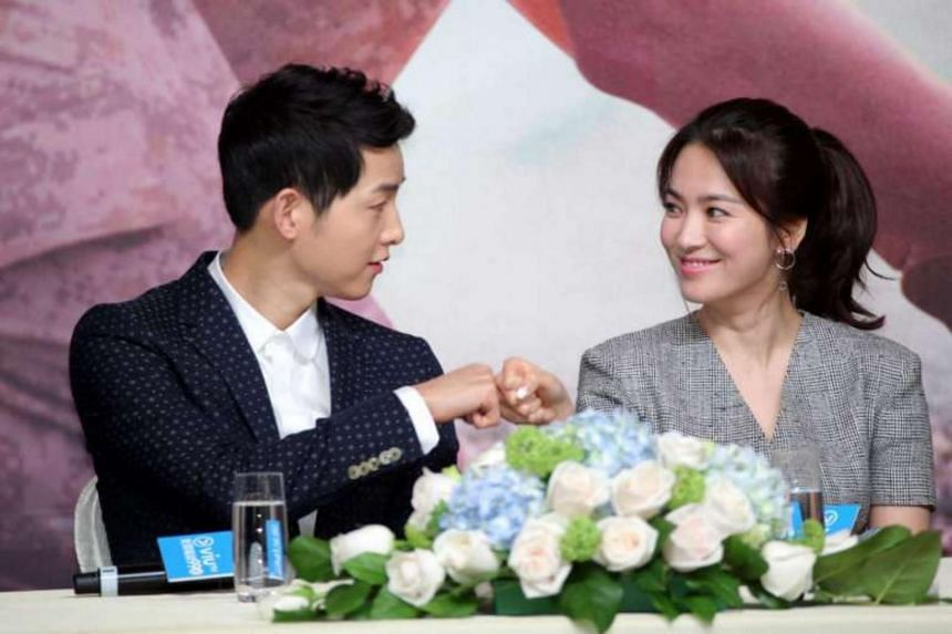Song Joong Ki (left) and Song Hye Kyo (right) at the press conference in Hong Kong for the new K-drama Descendants Of The Sun.